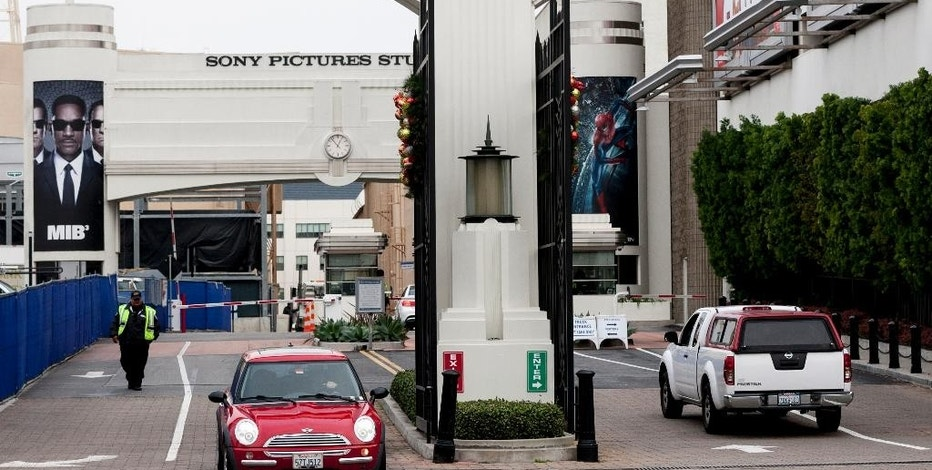 "FILE - In this Thursday, Dec. 18, 2014 file photo, cars enter and depart from Sony Pictures Entertainment studio lot in Culver City, Calif. In an unprecedented move, Sony Pictures broadly released ""The Interview"" to digital platforms Wednesday, Dec. 24, 2014, a reversal of its previous plan not to show the film after hackers released thousands of documents online and threatened violence at theaters showing the comedy that depicts the assassination of North Korean leader Kim Jong Un.  (AP Photo/Damian Dovarganes, File)"