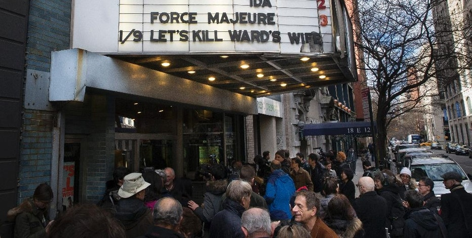 "Patrons wait in line to see ""The Interview"" at the Cinema Village movie theater, Thursday, Dec. 25, 2014, in New York. The film's Christmas Day release was canceled by Sony after threats of violence by hackers linked to North Korea, but the release was reinstated in some independent theaters and through a variety of digital platforms. (AP Photo/John Minchillo)"