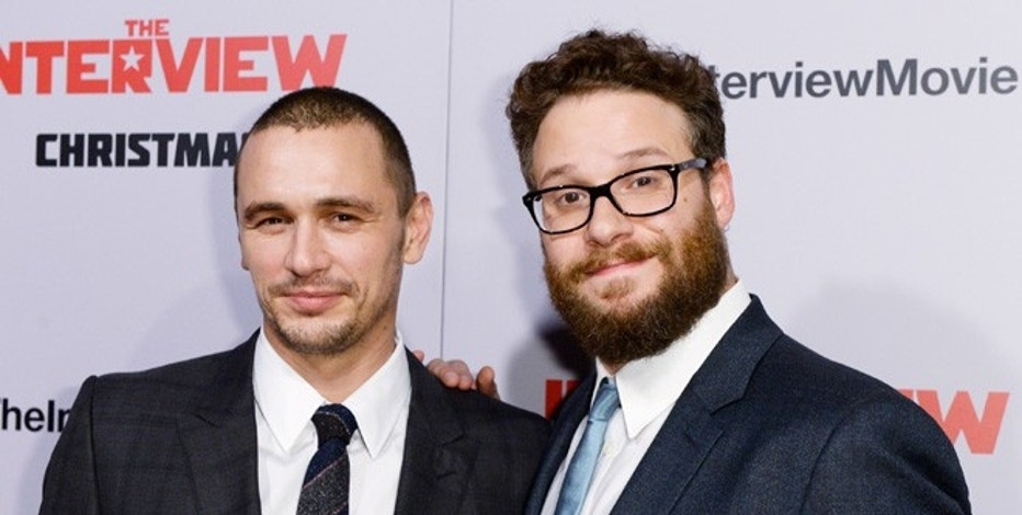 "Cast members James Franco (L) and Seth Rogen pose during premiere of the film ""The Interview"" in Los Angeles, California December 11, 2014."