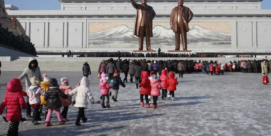 FILE - In thus Dec. 16, 2014 file photo, North Koreans gather at the Mansu Hill where the statues of the late leaders Kim Il Sung, and Kim Jong Il tower over them, in Pyongyang, North Korea. The U.S. is imposing sanctions on North Korea in retaliation for the cyberattack against Sony Pictures Entertainment. President Barack Obama signed an executive order on Friday authorizing the sanctions. Although the U.S. has already sanctioned North Korea over its nuclear program, these are the first sanctions punishing Pyongyang for alleged cyberattacks. (AP Photo/Wong Maye-E, File)