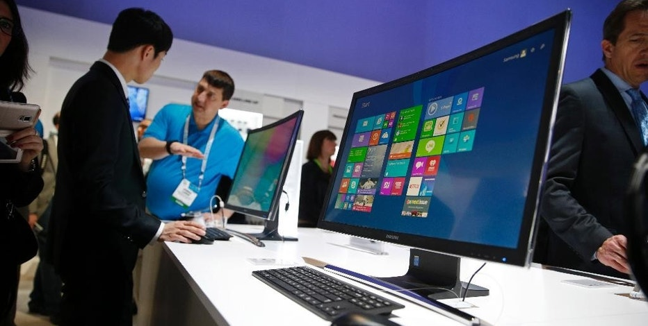 The ATIV One 7 Curved computer is on display at the Samsung booth during the International CES, Tuesday, Jan. 6, 2015, in Las Vegas. (AP Photo/John Locher)