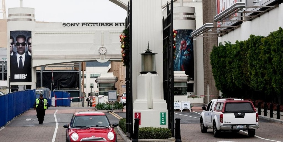 FILE - In this Thursday, Dec. 18, 2014 file photo, cars enter and depart from Sony Pictures Entertainment studio lot in Culver City, Calif. More than six weeks after hackers attacked Sony, its computer network is still down but the studio has not lost a single day of production on any of its films or television, CEO Michael Lynton told The Associated Press on Thursday, Jan. 8, 2015. In a wide-ranging interview Lynton talked about the company's isolation and the uncertainty that was created by the pre-Thanksgiving attack, which the U.S. government has attributed to North Korea.  (AP Photo/Damian Dovarganes, File)