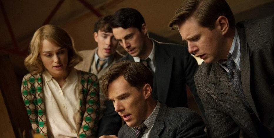 """FILE - This image released by The Weinstein Company shows, clockwise from left, Keira Knightley, Matthew Beard, Matthew Goode, Allen Leech and Benedict Cumberbatch in a scene from the film, """"The Imitation Game."""" The film was nominated for an Oscar Award for best feature on Thursday, Jan. 15, 2015. Cumberbatch was also nominated for best actor and Knightley for best supporting actress for their roles in the film. The once-classified home of Britain's World War II codebreakers is finally coming out of the shadows. Though eclipsed by attractions like the British Museum and Stonehenge, the museum at Bletchley Park expects a surge in visitors as a result of """"The Imitation Game,"""" a movie about Alan Turing, a computer science pioneer and architect of the effort to crack Nazi Germany's Enigma cipher.  (AP Photo/The Weinstein Company, Jack English)"""