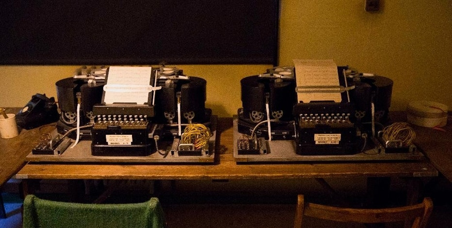"""In this Thursday, Jan. 15, 2015 photo, Typex machines are displayed at Bletchley Park museum in the town of Bletchley in Buckinghamshire, England. The movie """"The Imitation Game"""" is set at Bletchley Park and some scenes were filmed there. Though eclipsed by attractions like the British Museum and Stonehenge, the museum at Bletchley Park expects a surge in visitors as a result of the movie about Alan Turing, a computer science pioneer and architect of the effort to crack Nazi Germany's Enigma cipher. The film starring Benedict Cumberbatch was nominated for eight Academy Awards.  (AP Photo/Matt Dunham)"""