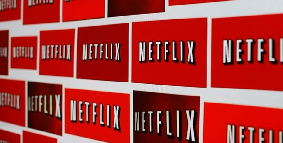 The Netflix logo is shown in this illustration photograph in Encinitas, California October 14, 2014. Netflix Inc <NFLX.O> shares were down 3.1 percent at $435.28 after the announcement. The streaming video company will announced its quarterly results later on October 15. Picture taken October 14, 2014. REUTERS/Mike Blake (UNITED STATES - Tags: ENTERTAINMENT MEDIA BUSINESS LOGO) - RTR4ABFO