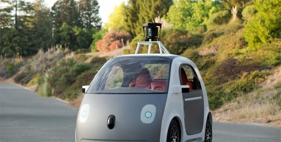 A very early version of Google Self-Driving Car Project vehicle.