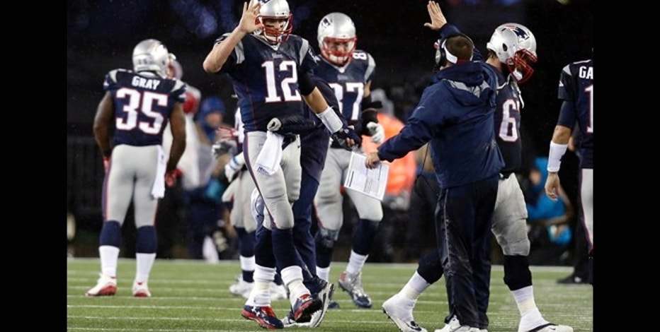 Jan 18, 2015; Foxborough, MA, USA; New England Patriots quarterback Tom Brady (12) celebrates with offensive coordinator Josh McDaniels after throwing a touchdown pass during the third quarter against the Indianapolis Colts in the AFC Championship Game at Gillette Stadium. Mandatory Credit: Greg M. Cooper-USA TODAY Sports - RTR4LXD3