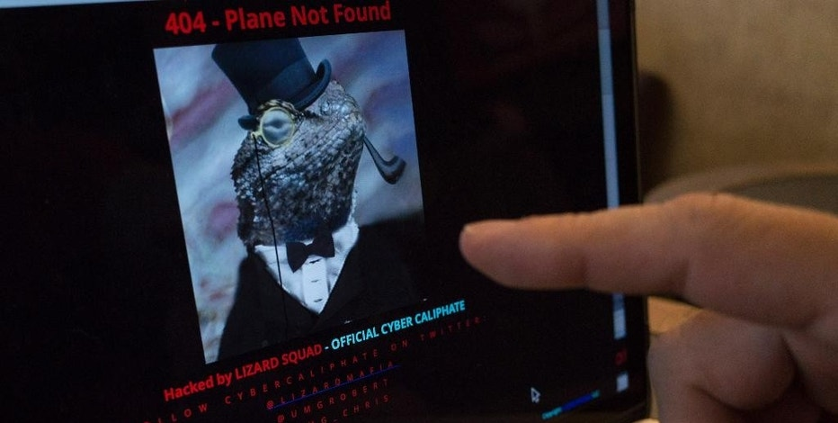 """A man points at the computer screen showing Malaysia Airlines' hacked website, at a cafe in Petaling Jaya outside Kuala Lumpur, Malaysia, Monday, Jan. 26, 2015. The airline's site was changed on Monday, at first with a message saying """"404 - Plane Not Found"""" and that it was """"Hacked by Cyber Caliphate."""" The browser tab for the website said """"ISIS will prevail."""" (AP Photo/Joshua Paul)"""