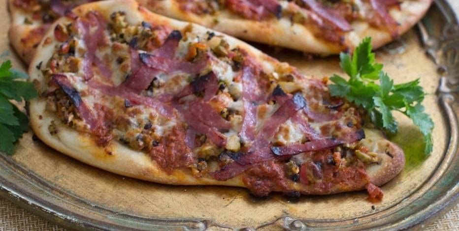 This Jan. 12, 2015 photo shows muffaletta flatbread in Concord, N.H. The recipe, by Alison Ladman, combines pizza and muffaletta. (AP Photo/Matthew Mead)