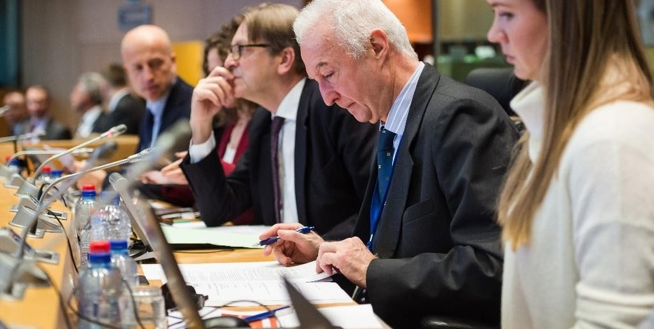 ALDE President Guy Verhofstadt, center, EU Counter-Terrorism chief Gilles de Kerchove, 2nd right, and Public Policy manager of Google Verity Harding attend a meeting of the Alliance of Liberals and Democrats for Europe (ALDE) on a counter-terrorism action plan, at the European Parliament in Brussels on Wednesday, Jan. 28, 2015. (AP Photo/Geert Vanden Wijngaert)
