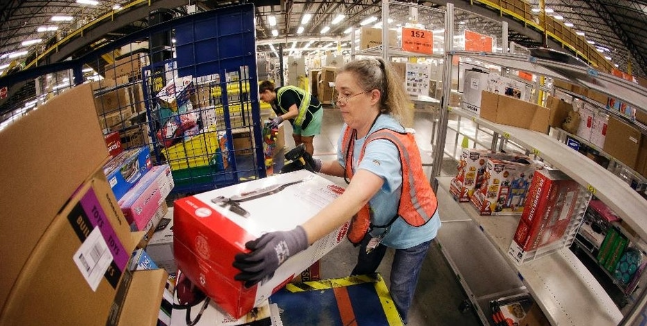 In this Dec. 1, 2014 photo, Teresa Clark fills an order at the Amazon fulfillment center in Lebanon, Tenn. Shares of Amazon.com jumped over 8 percent in aftermarket trading after the e-commerce giant beat quarterly profit expectations by a mile, the company announced, Thursday, Jan. 29, 2015. (AP Photo/Mark Humphrey)