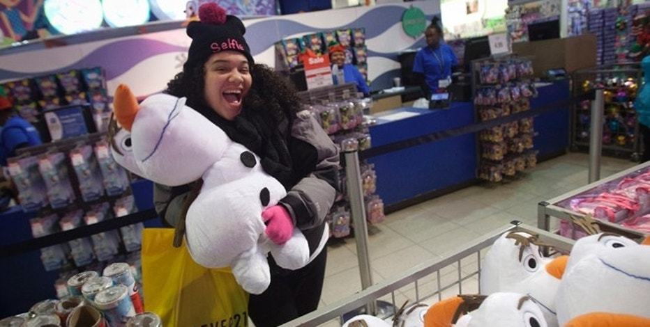 A girl poses with an Olaf plush toy from Disney's Frozen toy line at the Toys R Us store in Times Square in New York November 27, 2014. Toys R Us opened on Thanksgiving evening at 5pm, ahead of many other Black Friday retailers.   REUTERS/Carlo Allegri     (UNITED STATES - Tags: BUSINESS) - RTR4FW4Z