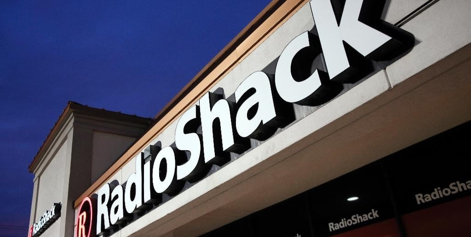 FILE - This Tuesday, Feb. 3, 2015 file photo shows a RadioShack store in Dallas. The electronics retailer filed for Chapter 11 bankruptcy protection on Thursday, Feb. 5, 2015. (AP Photo/Tony Gutierrez, File)