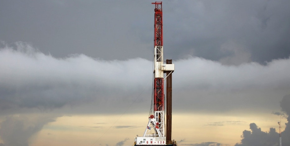 An oil rig of the Great Wall Drilling Company, a subsidiary of China National Petroleum Corp (CNPC), is seen near Varadero, around 140 kilometres (86 miles) east of Havana, September 4, 2011. China has signed an agreement to play a major role in increasing Cuban oil production both onshore and offshore, although details were not disclosed. State-owned CNPC is said to be considering leasing exploration blocks in Cuban waters. China also committed to negotiations of contracts for a $6 billion expansion of Cuba's Cienfuegos refinery and a liquefied natural gas project. Picture taken September 4, 2011. REUTERS/Desmond Boylan (CUBA - Tags: ENERGY BUSINESS POLITICS)