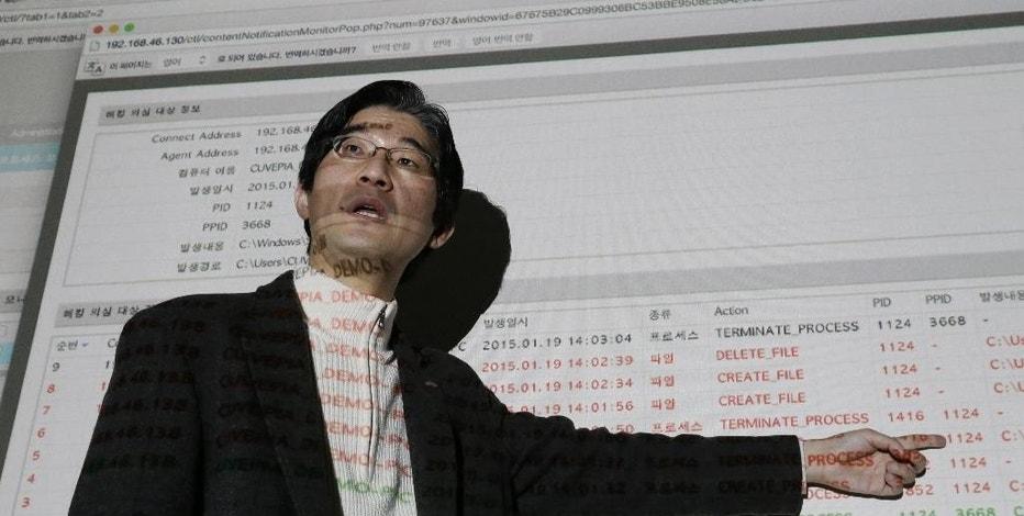 """In this Jan. 20, 2015, Kwon Seok-chul, CEO at computer security firm Cuvepia Inc., speaks as he presents """"Kwon-ga,"""" a real-time monitoring solution that detects hackers during an interview at his office in Seongnam, South Korea. Ever since the Internet blossomed in the 1990s, cybersecurity was built on the idea that computers could be protected by a digital quarantine. Now, as hackers routinely overwhelm such defenses, experts say cybersecurity is beyond due an overhaul. Their message: Neutralize attackers once they're inside networks rather than fixating on trying to keep them out. In South Korea, where government agencies and businesses have come under repeated attacks from hackers traced by Seoul to North Korea, several security firms have jumped on the growing global trend to develop systems that analyze activity to detect potentially suspicious patterns rather than scanning for known threats. Kwon said it has been tough to convince executives that it's more effective to catch bad guys after they've infiltrated a network instead of trying to keep them out, which he believes is impossible anyway. (AP Photo/Ahn Young-joon)"""