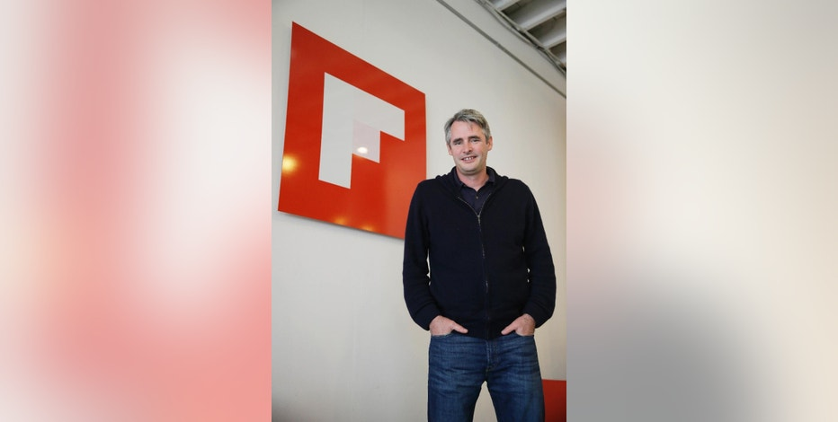 In this photo taken Thursday, Jan. 22, 2015, Flipboard founder and CEO Mike McCue poses at his company's headquarters in Palo Alto, Calif. McCue's digital magazine publishing service is expanding on to PCs for the first time with the Tuesday, Feb. 10, 2015 debut a version especially designed for Web browsers. Until now, Flipboard's full selection of 15 million magazines could only be read through a mobile app. (AP Photo/Eric Risberg)