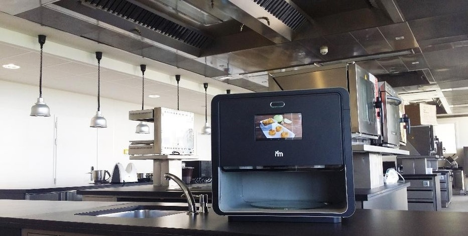 This undated photo provided by Natural Machines on Feb. 5, 2015 shows a Foodini food printer in a professional kitchen. Like more traditional 3-D printers, food printers work by printing out successive layers of edible material. (AP Photo/Natural Machines)