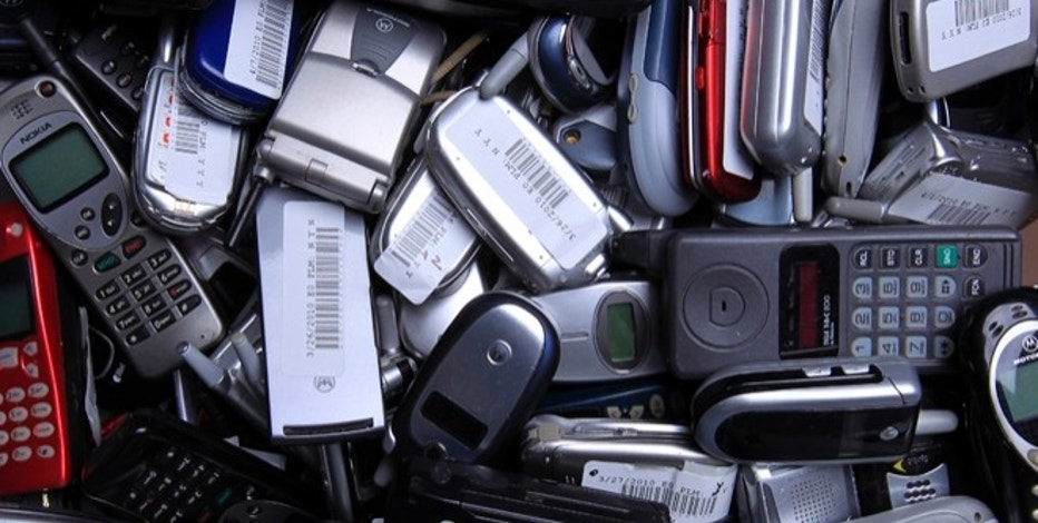 Hundreds of used cellphones sit waiting to be recycled at the offices of ECO ATM, a start-up company, in San Diego, California April 20, 2010. The eco-friendly company is building ATM type kiosks that allow a person to be instantly paid for recycling their old cell phone. Picture taken April 20, 2010. REUTERS/Mike Blake  (UNITED STATES - Tags: ENVIRONMENT SCI TECH SOCIETY BUSINESS) - RTR2D3BI