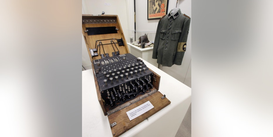 "A Nazi Enigma encryption machine is displayed at the World War II Museum in Natick, Mass., Wednesday, Feb. 18, 2015. In the Oscar-nominated film ""The Imitation Game,"" Benedict Cumberbatch leads a code-breaking operation targeting the Nazis' infamous Enigma encryption machines. The obscure suburban Boston museum boasts the largest U.S. collection of Enigmas outside of the NSA. (AP Photo/Elise Amendola)"