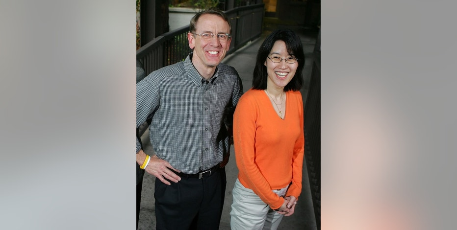 FILE - In this April 4, 2006 file photo, Kleiner Perkins Caulfield and Byers senior partner John Doerr poses for a portrait with partner Ellen Pao outside of their office in Menlo Park, Calif.  A jury is set to hear opening arguments this week in a multimillion-dollar sexual harassment lawsuit filed by Pao, currently interim chief of the news and social media site Reddit, against the prominent Silicon Valley venture capital firm. (AP Photo/Marcio Jose Sanchez, File)