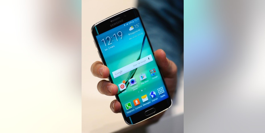 The new Galaxy S6 Edge is displayed during the Mobile World Congress, the world's largest mobile phone trade show in Barcelona, Spain, Monday, March 2, 2015. (AP Photo/Manu Fernandez)