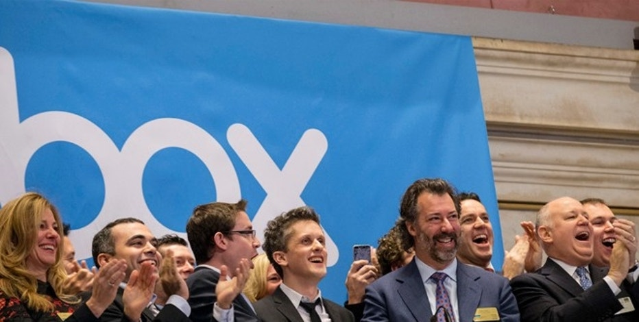Online data storage provider Box Inc Co-Founder and CEO Aaron Levie (C) rings the opening bell to celebrate his company's IPO at the New York Stock Exchange January 23, 2015. Box Inc's shares rose as much as 77 percent in their debut on Friday as investors shrugged off concerns about the company's ability to turn profitable in a highly competitive market. REUTERS/Brendan McDermid (UNITED STATES - Tags: BUSINESS SCIENCE TECHNOLOGY) - RTR4MO3A