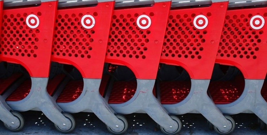 Shopping carts from a Target store are lined up in Encinitas, California May 22, 2013. Target Corp cut its full-year profit forecast on Wednesday while turning in a weak first quarter with disappointing sales, as a chilly start to spring kept shoppers from buying seasonal items like clothing. REUTERS/Mike Blake  (UNITED STATES - Tags: BUSINESS) - RTXZWZU