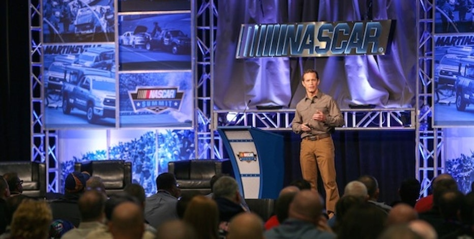 5.11 Tactical CEO Tom Davin speaks to the crowd at the 2015 NASCAR Summit.