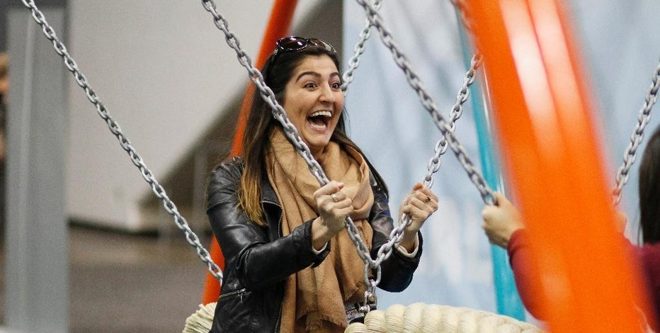 Sarah Hashemyan rides a swing in the Biba smart playground at the Game Developers Conference, Wednesday, March 4, 2015, in San Francisco. (AP Photo/=570509213Name=)