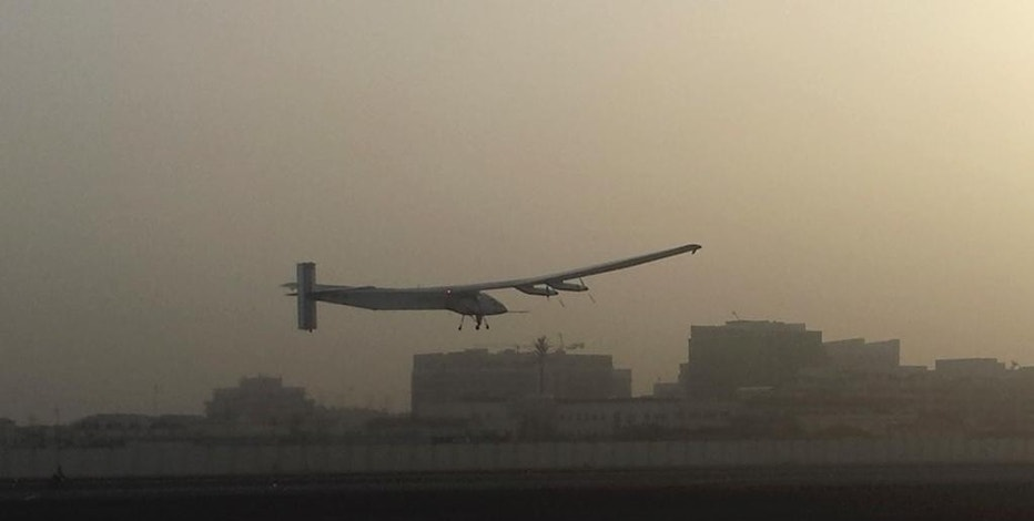 A Swiss solar-powered plane takes off at an airport in Abu Dhabi, United Arab Emirates, early Monday, March 9, 2015, marking the start of the first attempt to fly around the world without a drop of fuel. Solar Impulse founder Andre Borschberg was at the controls of the single-seater when it took off from the Al Bateen Executive Airport. Borschberg will trade off piloting with Solar Impulse co-founder Bertrand Piccard during stop-overs on a journey that will take months to complete. (AP Photo/Aya Batrawy)