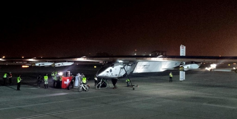 The Solar Impulse 2 prepares to depart at an airport in Abu Dhabi, United Arab Emirates, early Monday, March 9, 2015. The Swiss solar-powered plane took off from Abu Dhabi early Monday, marking the start of the first attempt to fly around the world without a drop of fuel. (AP Photo/Aya Batrawy)