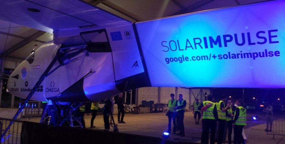 The Solar Impulse 2 prepares to depart from Abu Dhabi, United Arab Emirates, early Monday, March 9, 2015. The Swiss solar-powered plane took off from Abu Dhabi early Monday, marking the start of the first attempt to fly around the world without a drop of fuel. (AP Photo/Aya Batrawy)