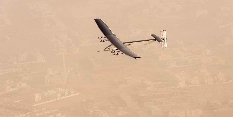 """In this photo released by Solar Impulse,  """"Solar Impulse 2"""", a solar-powered airplane flies after taking off from Al Bateen Executive Airport in Abu Dhabi, United Arab Emirates on Monday, March 9, 2015, marking the start of the first attempt to fly around the world without a drop of fuel. Solar Impulse founder Andre Borschberg was at the controls of the single-seater when it took off from the airport. Borschberg will trade off piloting with Solar Impulse co-founder Bertrand Piccard during stop-overs on a journey that will take months to complete. (AP Photo/Jean Revillard, Solar Impulse)"""