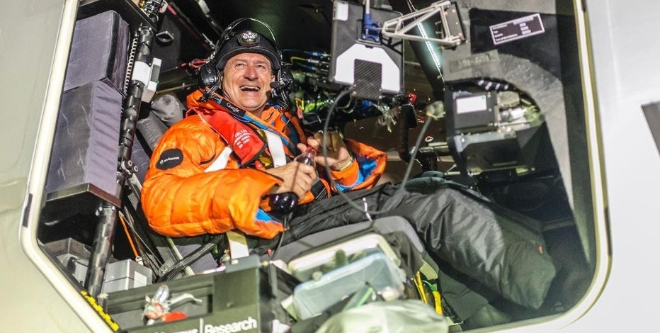 In this Monday, March 9, 2015 photo released by Solar Impulse, pilot Andre Boschberg reacts after landing a Swiss solar-powered plane in Muscat, Oman, after it took off from Abu Dhabi early Monday, marking the start of the first attempt to fly around the world without a drop of fuel. Solar Impulse founder Andre Borschberg was at the controls of the single-seater when it took off from the Al Bateen Executive Airport. (AP Photo/Jean Revillard and Olga Stefatou, Solar Impulse)