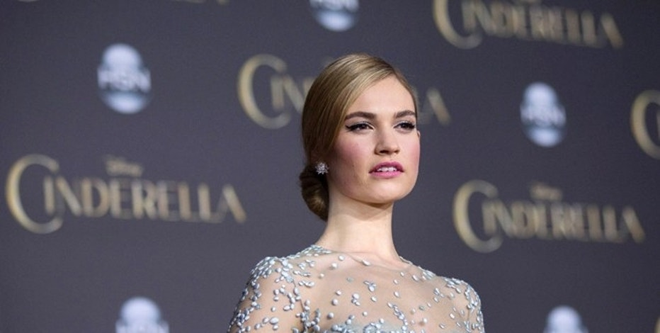 "Cast member Lily James poses at the premiere of ""Cinderella"" at El Capitan theatre in Hollywood, California March 1, 2015.  REUTERS/Mario Anzuoni"