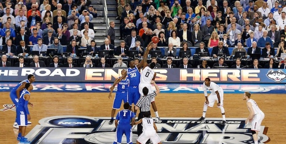 Apr 7, 2014; Arlington, TX, USA; Kentucky Wildcats forward Julius Randle (30) and Connecticut Huskies forward Phillip Nolan (0) go up for the tipoff in the first half during the championship game of the Final Four in the 2014 NCAA Mens Division I Championship tournament at AT&T Stadium. Mandatory Credit: Matthew Emmons-USA TODAY Sports - RTR3KC9R