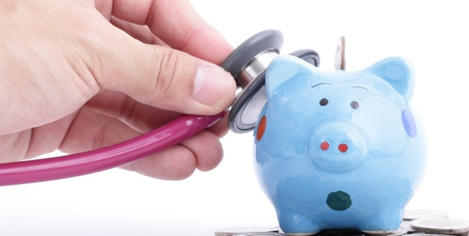 Blue Piggy bank with stethoscope for check your finance