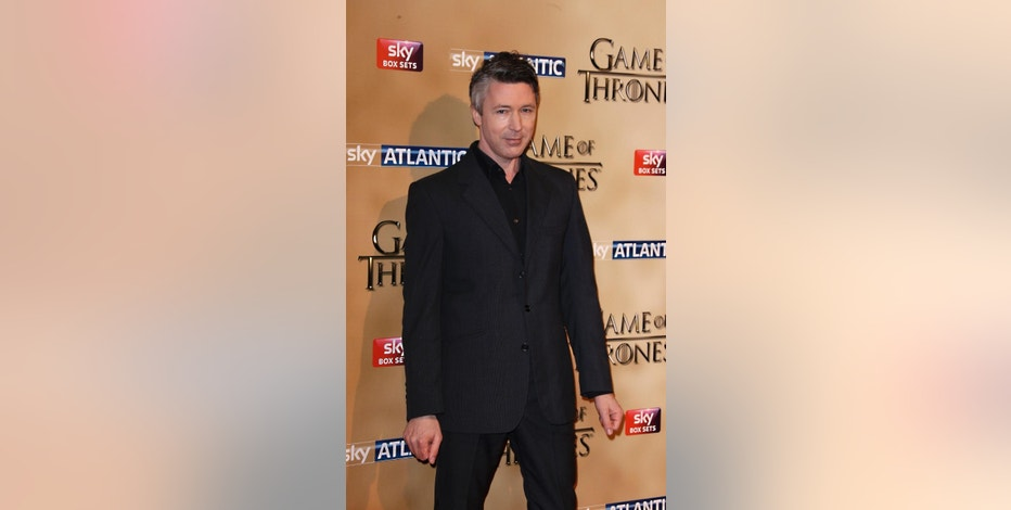 Aidan Gillen poses for photographers upon arrival at the Tower of London for the world premiere of Game of Thrones, season 5, in London Wednesday, March 18, 2015. (Photo by Joel Ryan/Invision/AP)