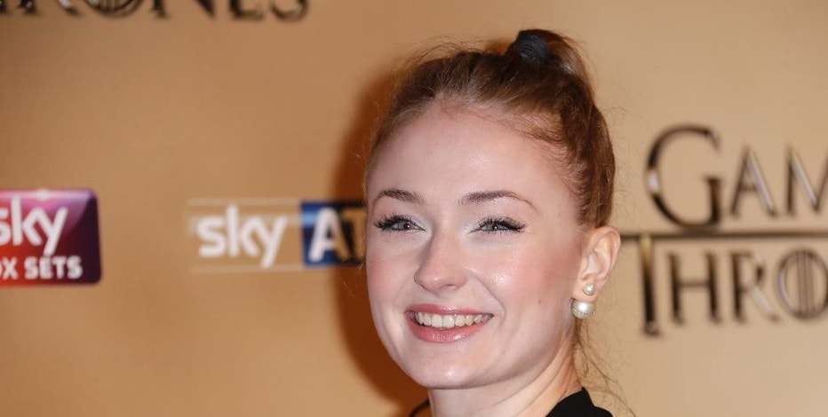 Sophie Turner poses for photographers upon arrival at the Tower of London for the world premiere of Game of Thrones, season 5, in London Wednesday, March 18, 2015. (Photo by Joel Ryan/Invision/AP)