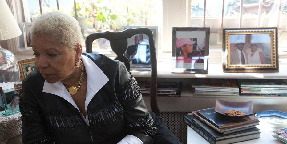 Fashion icon Audrey Smaltz listens during a interview in her rooftop penthouse at the Branson building, Tuesday, March 24, 2015, in New York. Smaltz, who is being pressured to move, is a permanent tenant in the building where the city is suing the landlord, saying a swath of the apartments were being used as hotel rooms. (AP Photo/Bebeto Matthews)