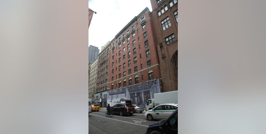 Traffic passes the Branson building on Tuesday, March 24, 2015 in New York.  The city is suing the landlords of the Branson building, saying a swath of the apartments were being used as hotel rooms.  (AP Photo/Bebeto Matthews)