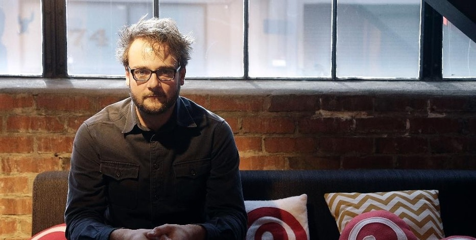 In this Nov. 13, 2014 photo, Pinterest co-founder Evan Sharp poses for photos at the Pinterest office in San Francisco. The San Francisco-based venture capital darling celebrated its fifth birthday in March 2015. (AP Photo/Jeff Chiu)