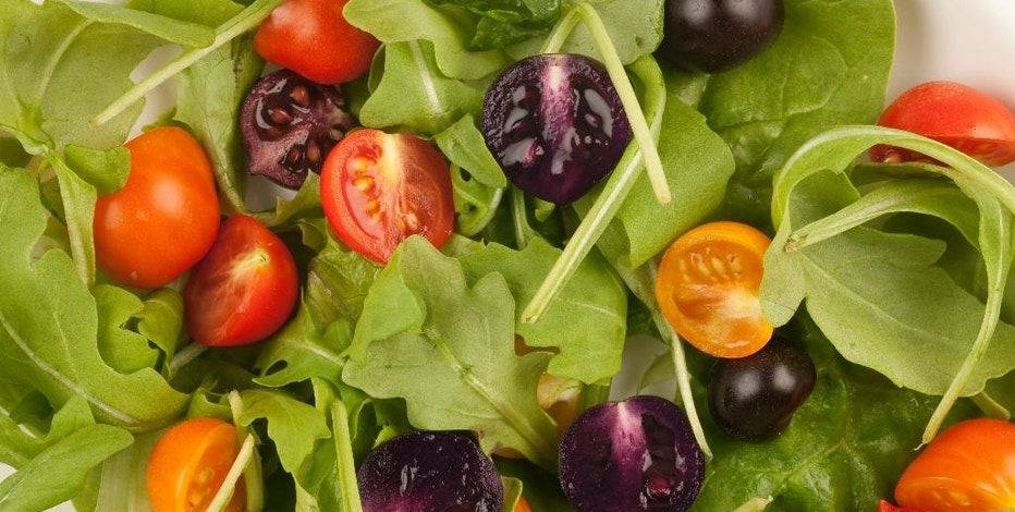 This image provided by The John Innes Centre, UK, shows a salad made with red and purple tomatoes. A small British company is planning to apply for U.S. permission to produce and sell purple tomatoes that have high levels of anthocyanins, compounds found in blueberries that some studies show lower the risk of cardiovascular disease and cancer. The Food and Drug Administration would have to approve any health claims used to sell the products. Cancer-fighting pink pineapples, heart-healthy purple tomatoes and less fatty vegetable oils may someday be on grocery shelves alongside more traditional products. (AP Photo/Andrew Davis, The John Innes Centre, UK)