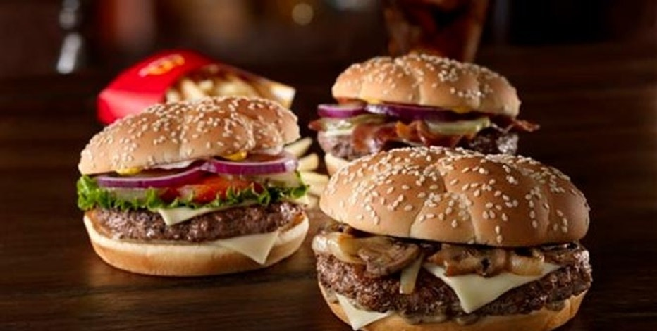 """This undated product image provided by McDonald's shows the fast food chain's new trio of """"Sirloin Third Pound"""" burgers: the Steakhouse, foreground right, Lettuce & Tomato, left, and Bacon & Cheese."""