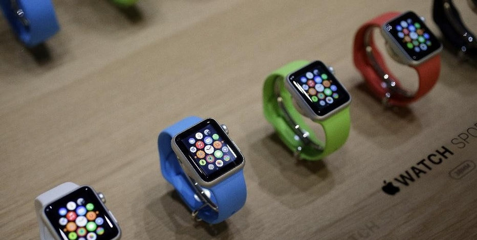 FILE - In this March 9, 2015, file photo, varieties of the new Apple Watch appear on display in the demo room after an Apple event in San Francisco. Pre-orders for the Apple Watch start April 10. The device costs $349 for a base model, while a luxury gold version will go for $10,000. (AP Photo/Eric Risberg, File)
