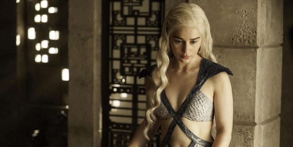 "In this image released by HBO, Daenerys Targaryen, portrayed by Emilia Clarke, appears in a scene from season four of ""Game of Thrones."" The 5th season of the show premiered on Sunday, April 12, 2015. (AP Photo/HBO, Helen Sloan)"