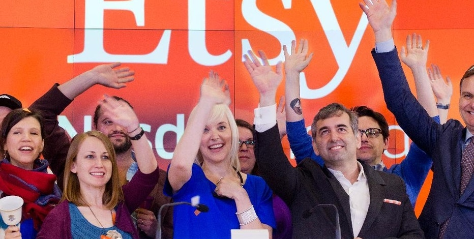 Kristina Salen, center left, Etsy's Chief Financial Officer, stands with Chad Dickerson, center right, Chairman and CEO, to celebrate the company's IPO with employees and guests at the Nasdaq MarketSite, Thursday, April 16, 2015, in New York. (AP Photo/Mark Lennihan)