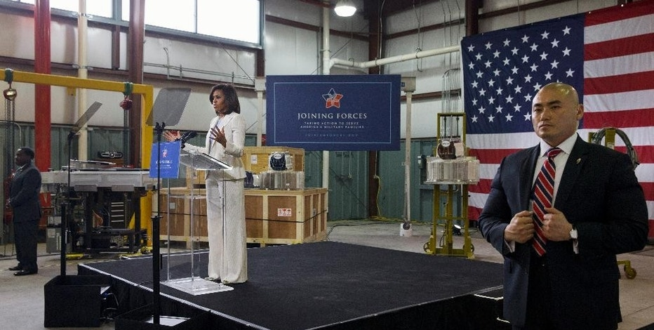 First lady Michelle Obama speaks at Micron Technology, Inc., a semiconductor manufacturer, Thursday, April 23, 2015, in Manassas, Va., to announce new commitments to train and hire veterans, and military spouses. (AP Photo/Jacquelyn Martin)