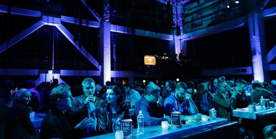People mingle as they wait for a performance at SoundBox on Friday, April 10, 2015, in San Francisco. With an average audience age over 60, the San Francisco Symphony wanted to reach a younger audience for classical music. They created a new high-tech venue that looks like a Vegas nightclub, until the music starts. (AP Photo/Marcio Jose Sanchez)