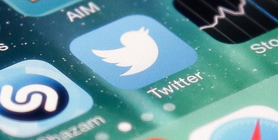 FILE - This Nov. 4, 2013 file photo shows the icon for the Twitter app on an iPhone in San Jose, Calif. Twitter Inc. reports quarterly financial results after the market closes Tuesday, April 28, 2015. (AP Photo/Marcio Jose Sanchez, File)